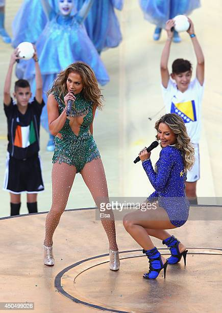 Singers Jennifer Lopez and Claudia Leitte perform during the Opening Ceremony of the 2014 FIFA World Cup Brazil prior to the Group A match between...