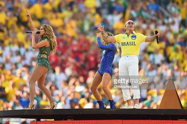Singers Jennifer Lopez Claudia Leitte and Pitbull perform during the Opening Ceremony of the 2014 FIFA World Cup Brazil prior to the Group A match...