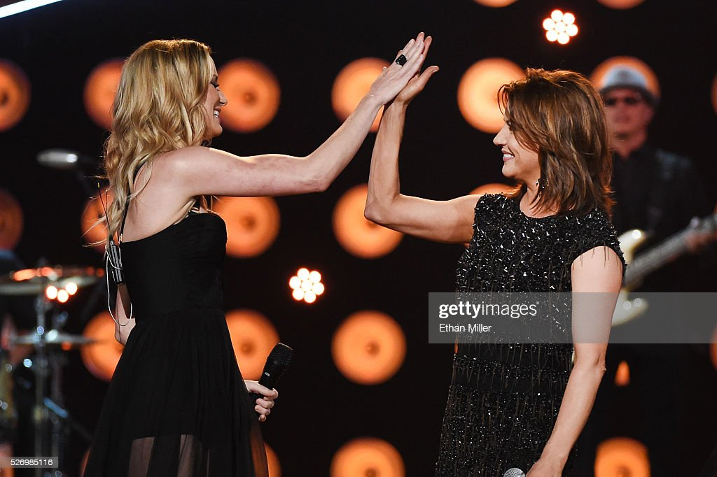 Singers Jennifer Nettles (L) and Martina McBride perform onstage during the 2016 American Country Countdown Awards at The Forum on May 1, 2016 in Inglewood, California.