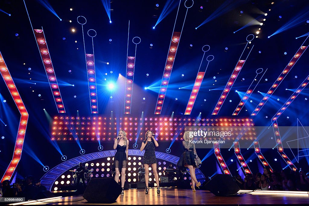 Singers Kelsea Ballerini, Martina McBride, and Cam perform onstage during the 2016 American Country Countdown Awards at The Forum on May 1, 2016 in Inglewood, California.