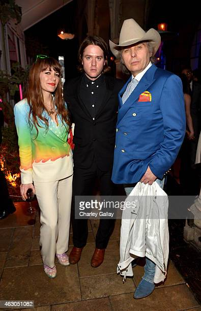 Singers Jenny Lewis Johnathan Rice and Dwight Yoakam attend the Warner Music Group annual Grammy celebration at Chateau Marmont on February 8 2015 in...