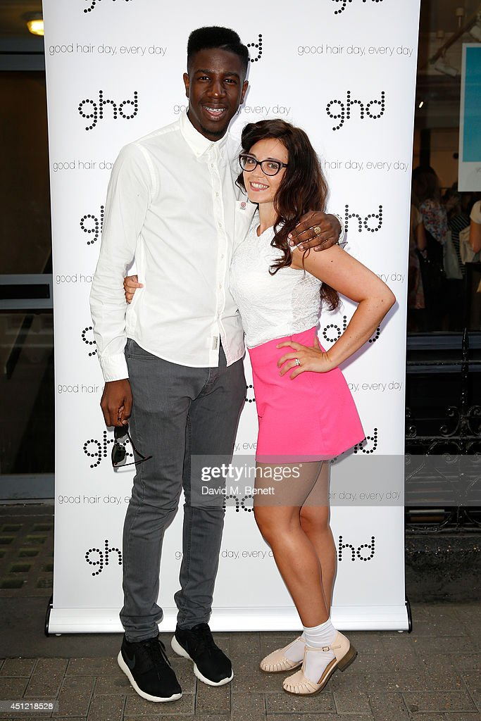 Singers Jermain Jackman (L) and Georgia Harrup attend ghd's exhibition of iconic beauty must-haves to celebrate the launch of ghd aura, a ground-breaking drying and styling tool on June 25, 2014 in London, England.