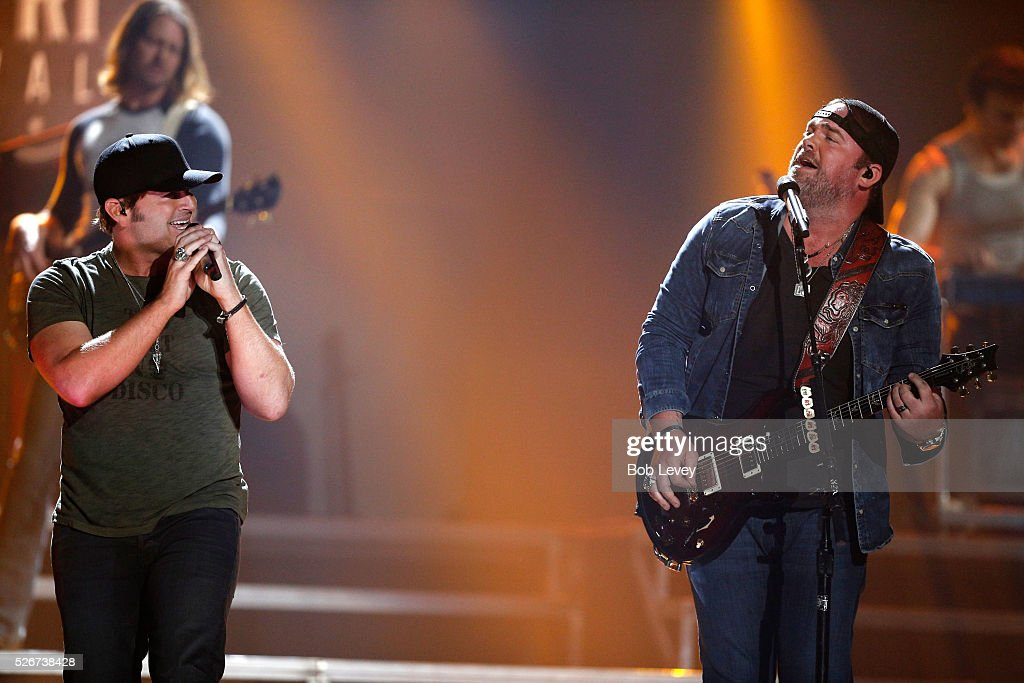 Singers Jerrod Niemann (L) and Lee Brice perform onstage during the 2016 iHeartCountry Festival at The Frank Erwin Center on April 30, 2016 in Austin, Texas.