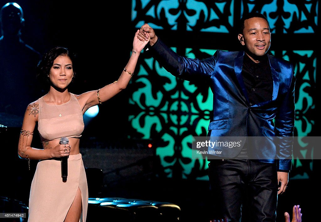 Singers Jhene Aiko and John Legend perform onstage during the BET AWARDS '14 at Nokia Theatre LA LIVE on June 29 2014 in Los Angeles California