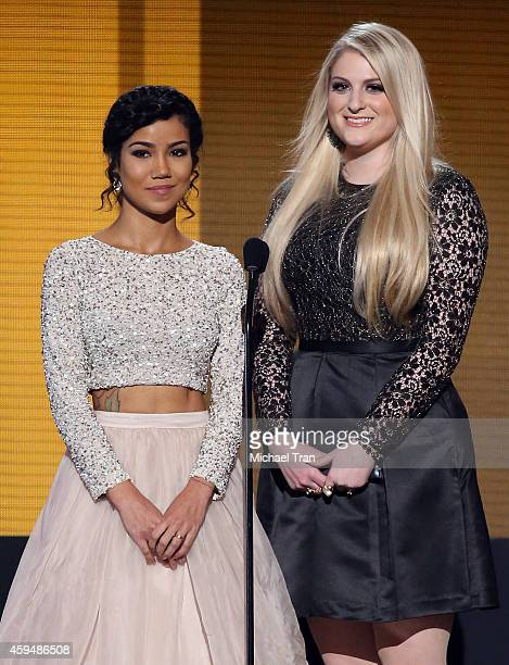 Singers Jhene Aiko and Meghan Trainor speak onstage during the 2014 American Music Awards held at Nokia Theatre LA Live on November 23 2014 in Los...