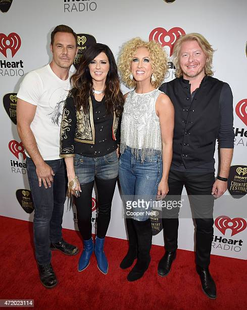 Singers Jimi Westbrook Karen Fairchild Kimberly Schlapman and Philip Sweet of Little Big Town pose backstage at the 2015 iHeartRadio Country Festival...