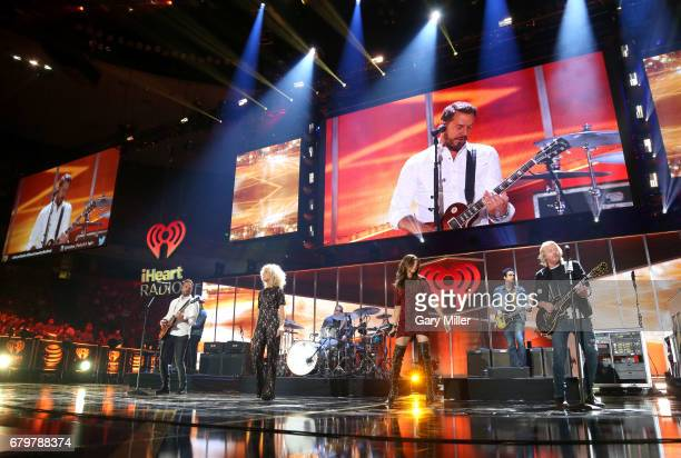 Singers Jimi Westbrook Kimberly Schlapman Karen Fairchild and Phillip Sweet of Little Big Town perform onstage during the 2017 iHeartCountry Festival...
