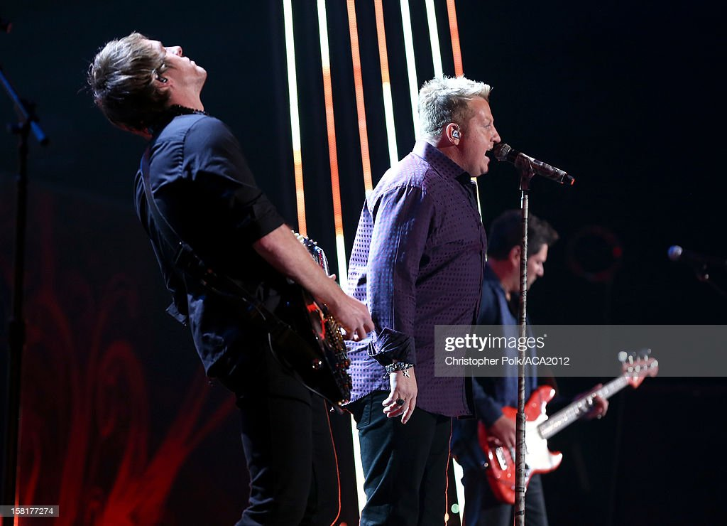 Singers Joe Don Rooney and Gary LeVox of Rascal Flatts perform onstage during the 2012 American Country Awards at the Mandalay Bay Events Center on December 10, 2012 in Las Vegas, Nevada.