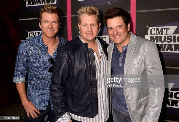 Singers Joe Don Rooney Gary LeVox and Jay DeMarcus of Rascal Flatts arrive at the 2013 CMT Music Awards at the Bridgestone Arena on June 5 2013 in...