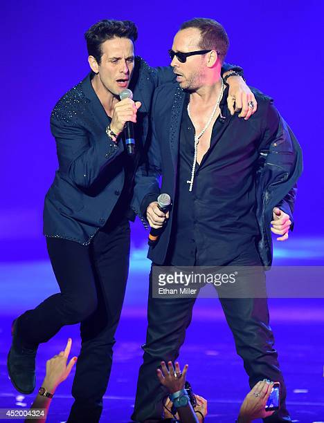 Singers Joey McIntyre and Donnie Wahlberg of New Kids on the Block perform during the first show of the group's fournight run at The Axis at Planet...