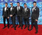 Singers Joey McIntyre Donnie Wahlberg Jonathan Knight Danny Wood and Jordan Knight of New Kids on the Block arrive at the 'American Idol' XIV Grand...