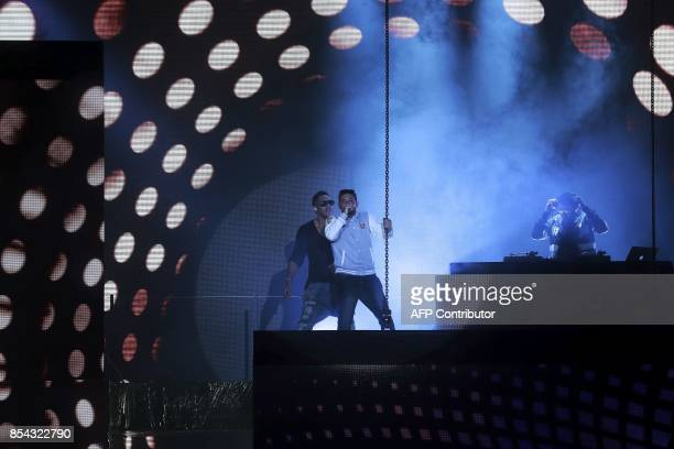 Singers Joey Starr and Kool Shen of French band NTM perform during Etam Live show in Paris on September 26 2017 / AFP PHOTO / Jacques Demarthon