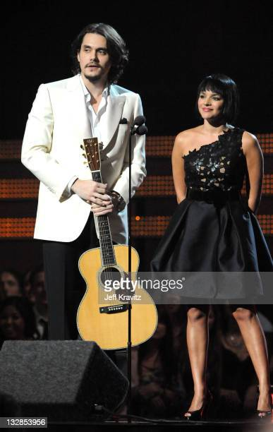Singers John Mayer and Norah Jones speak onstage during The 53rd Annual GRAMMY Awards held at Staples Center on February 13 2011 in Los Angeles...