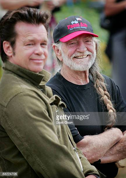 Singers John Mellencamp and Willie Nelson announce plans for an event marking the 20th anniversary of Farm Aid during a news conference July 11 2005...