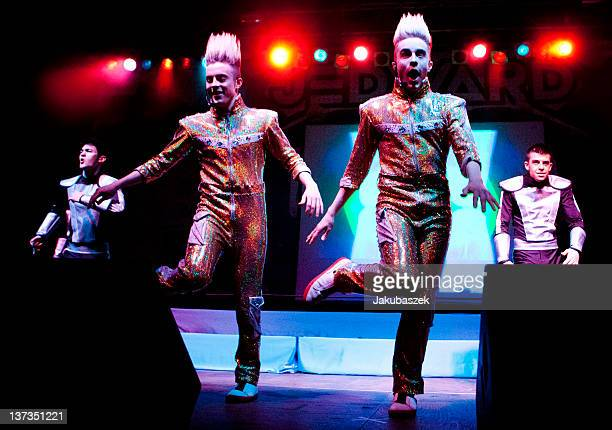 Singers John Paul Henry Daniel Richard Grimes and Edward Peter Anthony Kevin Patrick Grimes of the Irish band Jedward perform live during a concert...