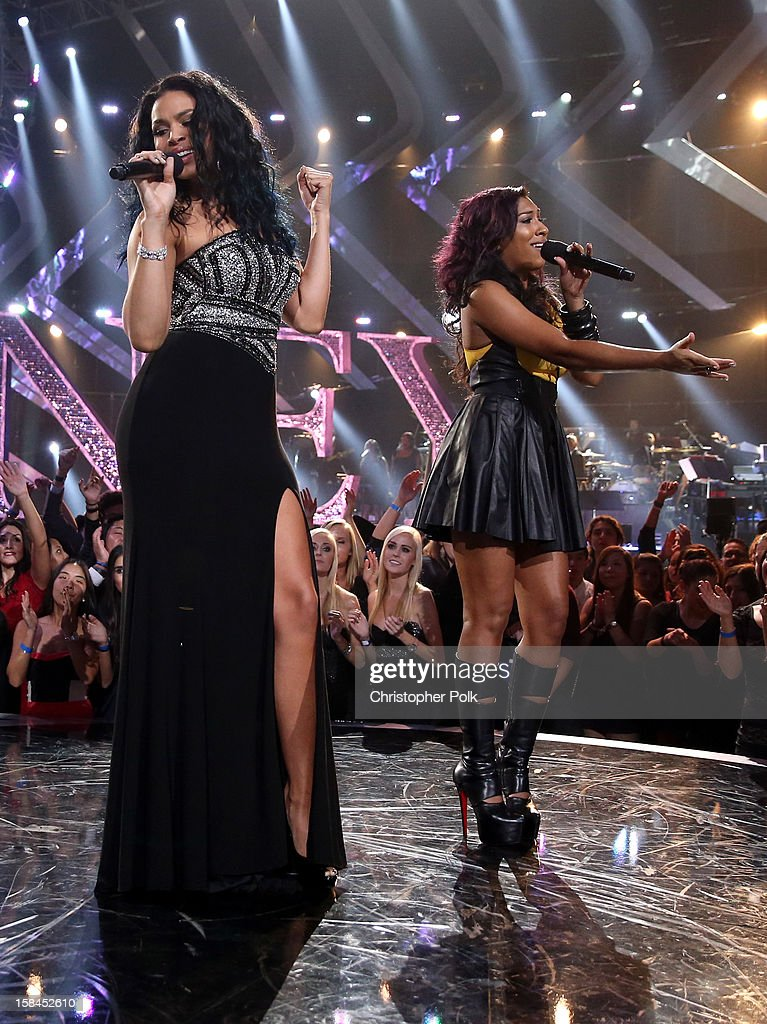 Singers Jordin Sparks and Melanie Fiona perform onstage during 'VH1 Divas' 2012 at The Shrine Auditorium on December 16, 2012 in Los Angeles, California.