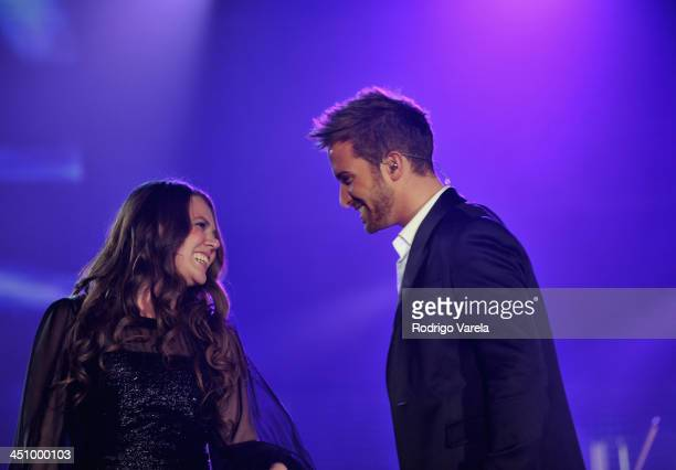 Singers Joy Huerta and Pablo Alboran perform onstage during the 2013 Person of the Year honoring Miguel Bose at the Mandalay Bay Convention Center on...