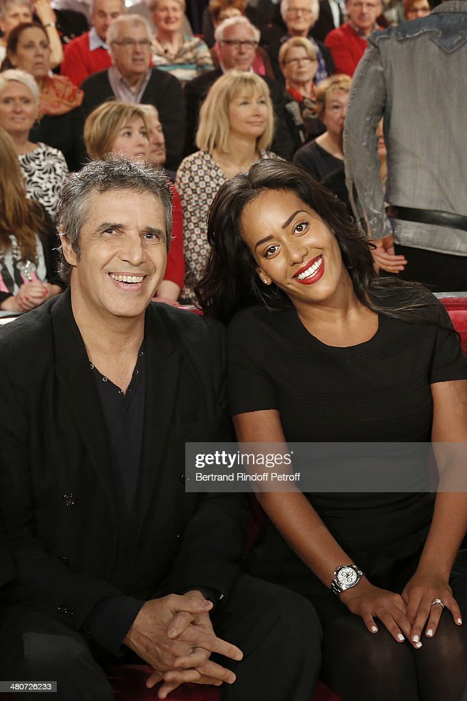 Singers Julien Clerc (L) and Amel Bent pose during the recording of Michel Drucker's 'Vivement Dimanche' weekly show at Pavillon Gabriel on March 26, 2014 in Paris, France.