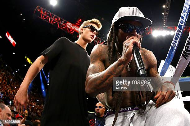 Singers Justin Bieber and Lil Wayne enter the ring with Floyd Mayweather Jr before Mayweather Jr takes on Canelo Alvarez in their WBC/WBA 154pound...
