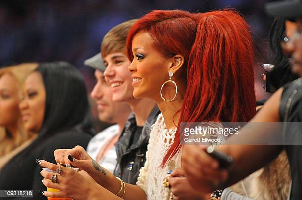 Singers Justin Bieber and Rihanna sit courtside during the 2011 NBA All Star Game at Staples Center on February 20 2011 in Los Angeles California...