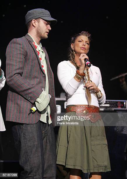 Singers Justin Timberlake and Fergie of the Black Eyed Peas perform at the WillIAm Music Group launch and Tsunami Benefit concert on February 11 2005...
