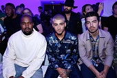 Singers Kanye West Zayn Malik and Joe Jonas attend the Louis Vuitton Menswear Spring/Summer 2016 show as part of Paris Fashion Week on June 25 2015...