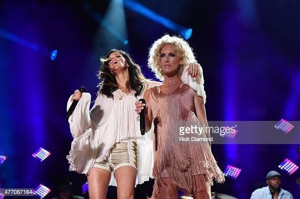 Singers Karen Fairchild and Kimberly Schlapman of Little Big Town perform onstage during the 2015 CMA Festival on June 13 2015 in Nashville Tennessee
