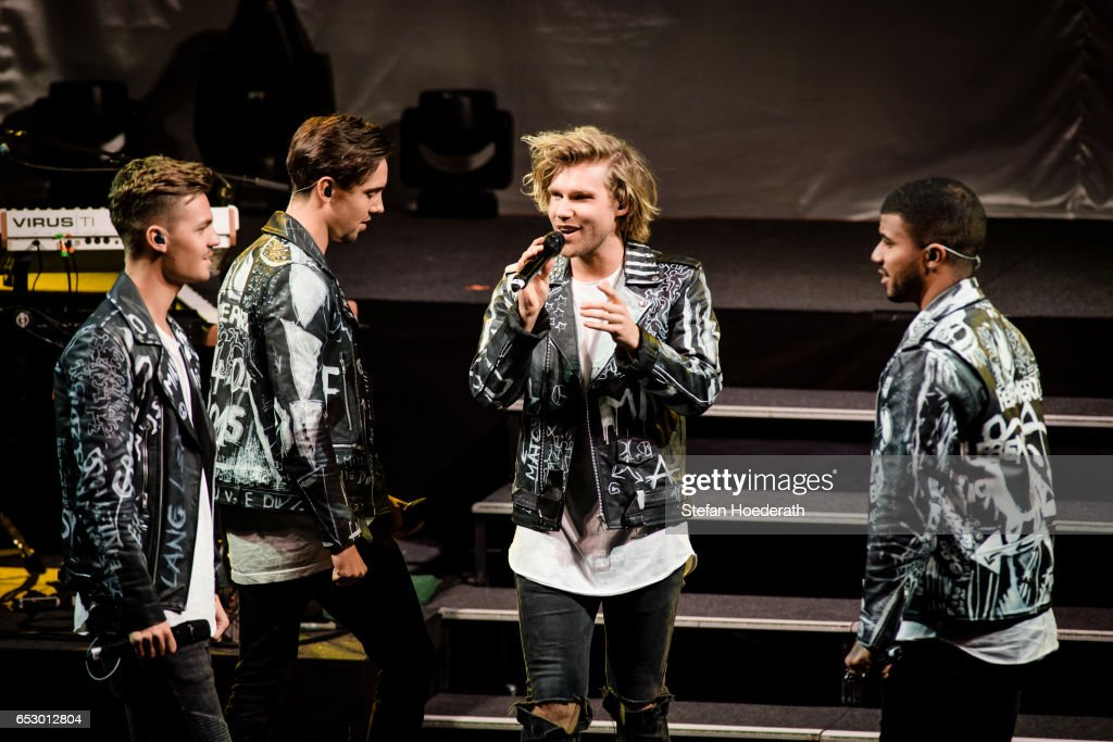 Singers Karsten Walter, Sebastian Wurth, Martijn Stoffers and Dominique Bircan Baltas of boygroup Feuerherz perform live on stage during a concert as support for Maite Kelly at Friedrichstadtpalast on March 13, 2017 in Berlin, Germany.