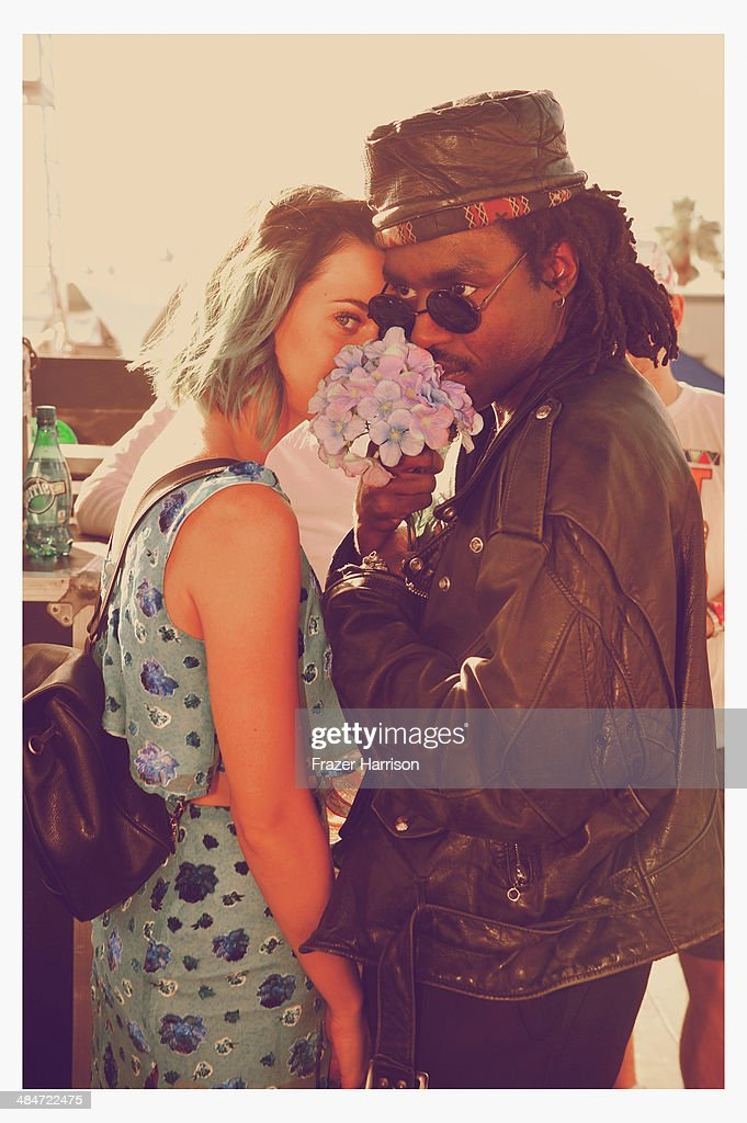 Singers Katy Perry (L) and Blood Orange attend day 3 of the 2014 Coachella Valley Music & Arts Festival at the Empire Polo Club on April 13, 2014 in Indio, California.
