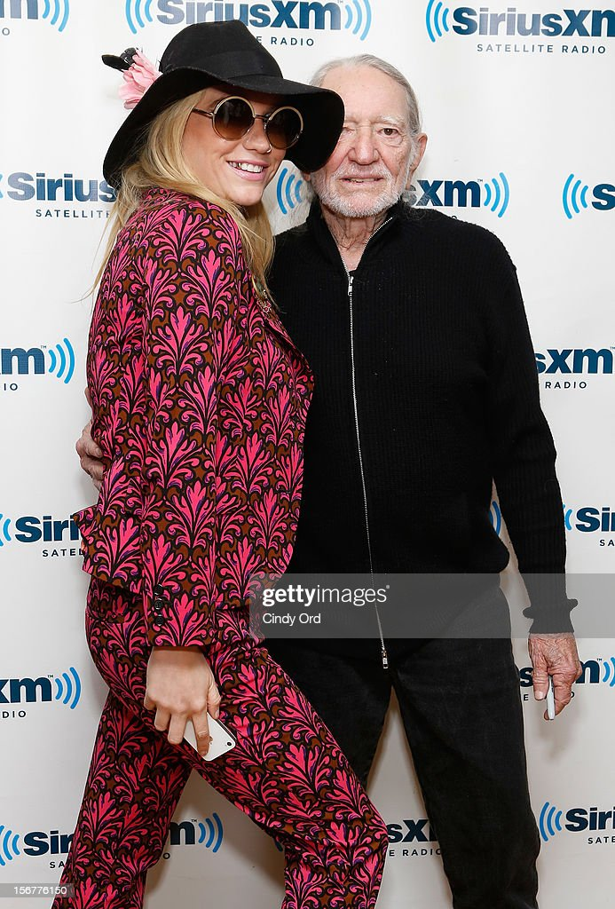 Singers Ke$ha and Willie Nelson pose at the SiriusXM Studios on November 20, 2012 in New York City.