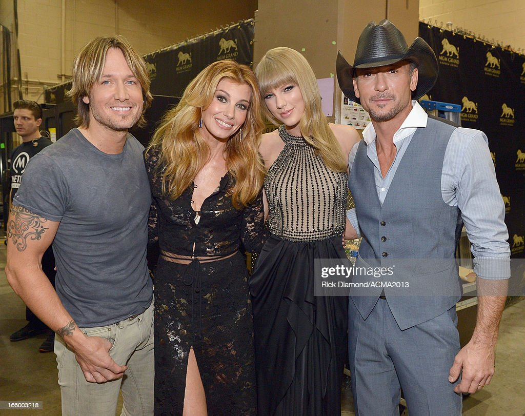 Singers <a gi-track='captionPersonalityLinkClicked' href=/galleries/search?phrase=Keith+Urban&family=editorial&specificpeople=202997 ng-click='$event.stopPropagation()'>Keith Urban</a>, <a gi-track='captionPersonalityLinkClicked' href=/galleries/search?phrase=Faith+Hill&family=editorial&specificpeople=175933 ng-click='$event.stopPropagation()'>Faith Hill</a>, <a gi-track='captionPersonalityLinkClicked' href=/galleries/search?phrase=Taylor+Swift&family=editorial&specificpeople=619504 ng-click='$event.stopPropagation()'>Taylor Swift</a> and <a gi-track='captionPersonalityLinkClicked' href=/galleries/search?phrase=Tim+McGraw&family=editorial&specificpeople=202845 ng-click='$event.stopPropagation()'>Tim McGraw</a> attend the 48th Annual Academy of Country Music Awards at the MGM Grand Garden Arena on April 7, 2013 in Las Vegas, Nevada.