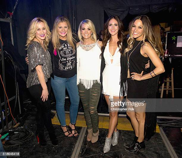 Singers Kellie Pickler Lauren Alaina Carrie Underwood Kelleigh Bannen and Jana Kramer pose backstage at the 4th ACM Party for a Cause Festival at the...