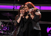 Singers Kelly Clarkson and Demi Lovato perform onstage during Z100's Jingle Ball 2011 presented by Aeropostale at Madison Square Garden on December 9...