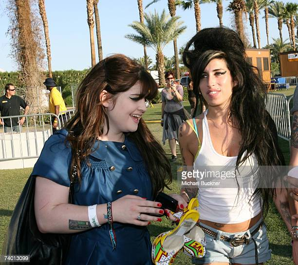 Singers Kelly Osbourne and Amy Winehouse attend day 1 of the Coachella Music Festival held at the Empire Polo Field on April 27 2007 in Indio...