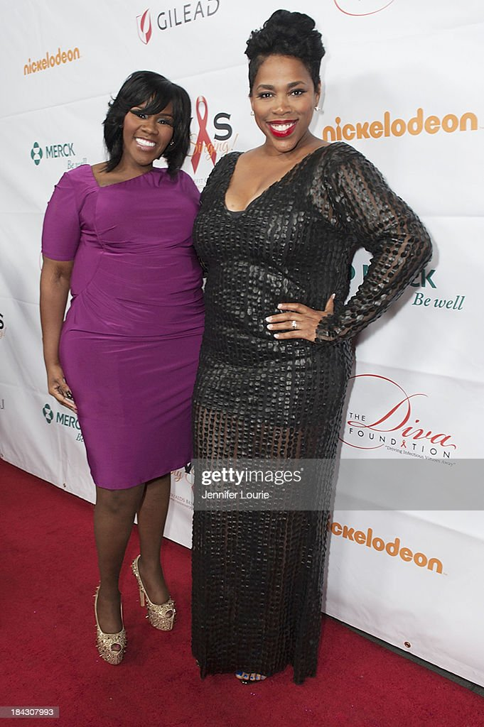 Singers Kelly Price and Nicci Gilbert attend the 23rd Annual HIV/AIDS benefit concert DIVAS Simply Singing! at Club Nokia on October 12, 2013 in Los Angeles, California.