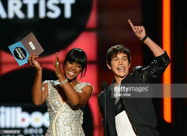 Singers Kelly Rowland and Austin Mahone present the award for Top EDM Artist onstage during the 2013 Billboard Music Awards at the MGM Grand Garden...