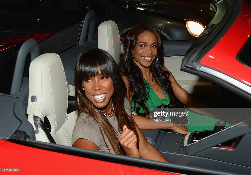 Singers <a gi-track='captionPersonalityLinkClicked' href=/galleries/search?phrase=Kelly+Rowland&family=editorial&specificpeople=201760 ng-click='$event.stopPropagation()'>Kelly Rowland</a> and Michelle Williams pose at the 'Jaguar and Gilt celebrate #MyTurnToJag' held at Siren Studios on July 23, 2013 in Hollywood, California.