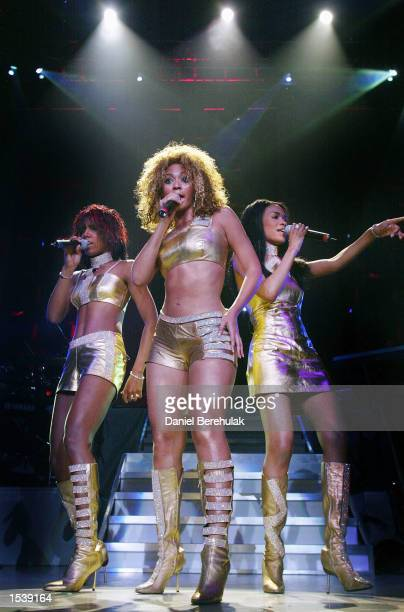 Singers Kelly Rowland Beyonce Knowles and Michelle Williams of the musical group Destiny's Child performs May 1 2002 in Sydney Australia