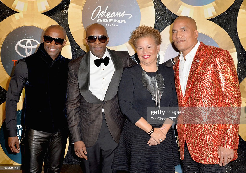 Singers Kem Joe Debra Lee Chairman and CEO of BET and Paxton Baker Executive Vice President and General Manager of Centric attend the 2014 Soul Train...
