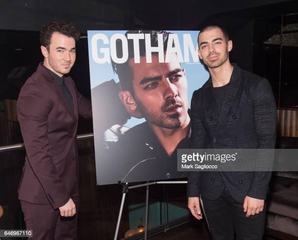 Singers Kevin Jonas and Joe Jonas attend Gotham Magazine's Intimate Evening with Cover Star Joe Jonas on March 1 2017 at the VNYL Vintage New York...