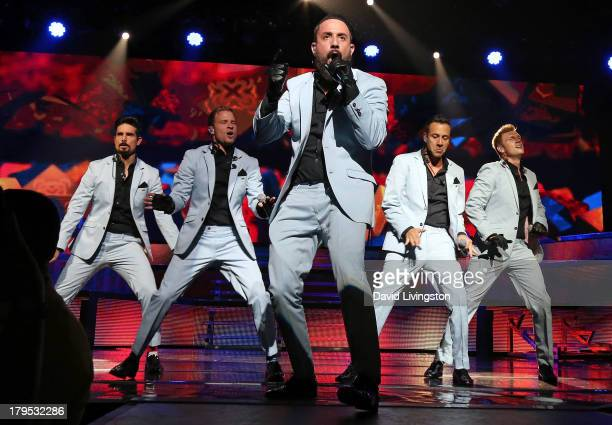 Singers Kevin Richardson Brian Littrell AJ McLean Howie Dorough and Nick Carter of the Backstreet Boys perform on stage at the Gibson Amphitheatre on...