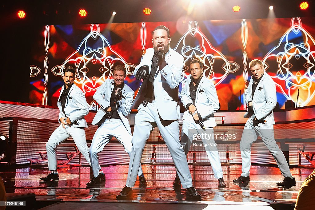 Singers Kevin Richardson, Brian Littrell, AJ McLean, Howie Dorough and Nick Carter of Backstreet Boys perform at Backstreet Boys In Concert at Gibson Amphitheatre on September 4, 2013 in Universal City, California.