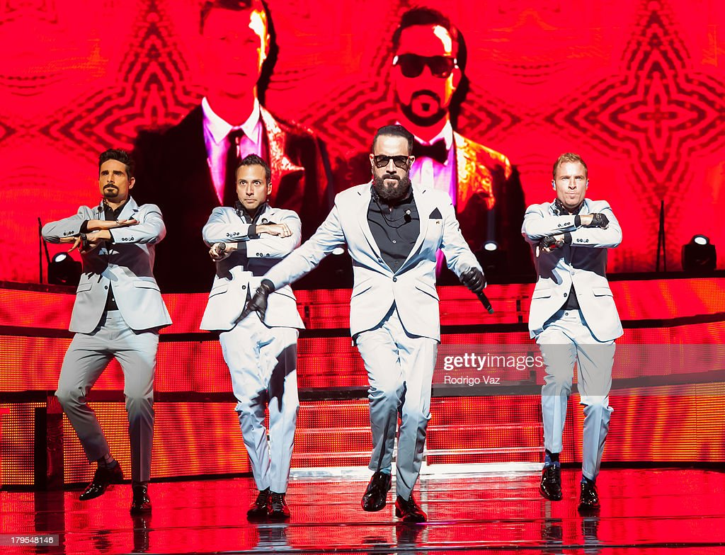 Singers Kevin Richardson, Howie Dorough, AJ McLean and Brian Littrell of Backstreet Boys performs at Backstreet Boys In Concert at Gibson Amphitheatre on September 4, 2013 in Universal City, California.