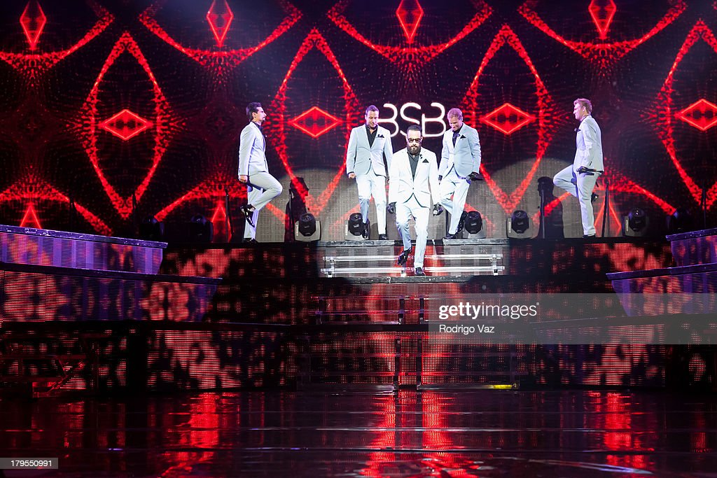 Singers Kevin Richardson, Howie Dorough, AJ McLean, Brian Littrell and Nick Carter of Backstreet Boys performs at Backstreet Boys In Concert at Gibson Amphitheatre on September 4, 2013 in Universal City, California.