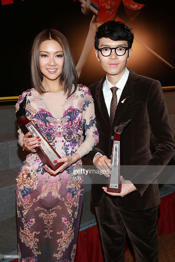 Singers <a gi-track='captionPersonalityLinkClicked' href=/galleries/search?phrase=Khalil+Fong&family=editorial&specificpeople=5659776 ng-click='$event.stopPropagation()'>Khalil Fong</a> and Fiona Sit (L) attend 2012 Chic Chak Music Awards at Hong Kong Convention and Exhibition Center on January 2, 2013 in Hong Kong, Hong Kong.