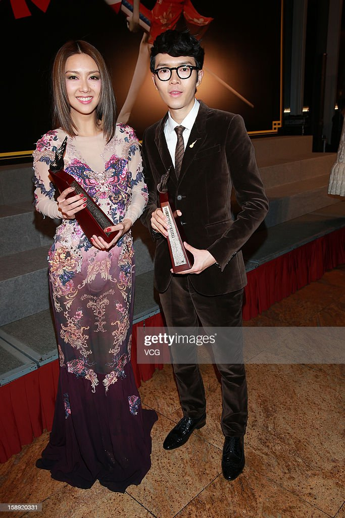Singers Khalil Fong and Fiona Sit (L) attend 2012 Chic Chak Music Awards at Hong Kong Convention and Exhibition Center on January 2, 2013 in Hong Kong, Hong Kong.