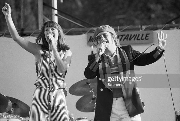 Singers Kiki Dee and Elton John perform at the Dr Pepper Music Festival at New York City's Central Park