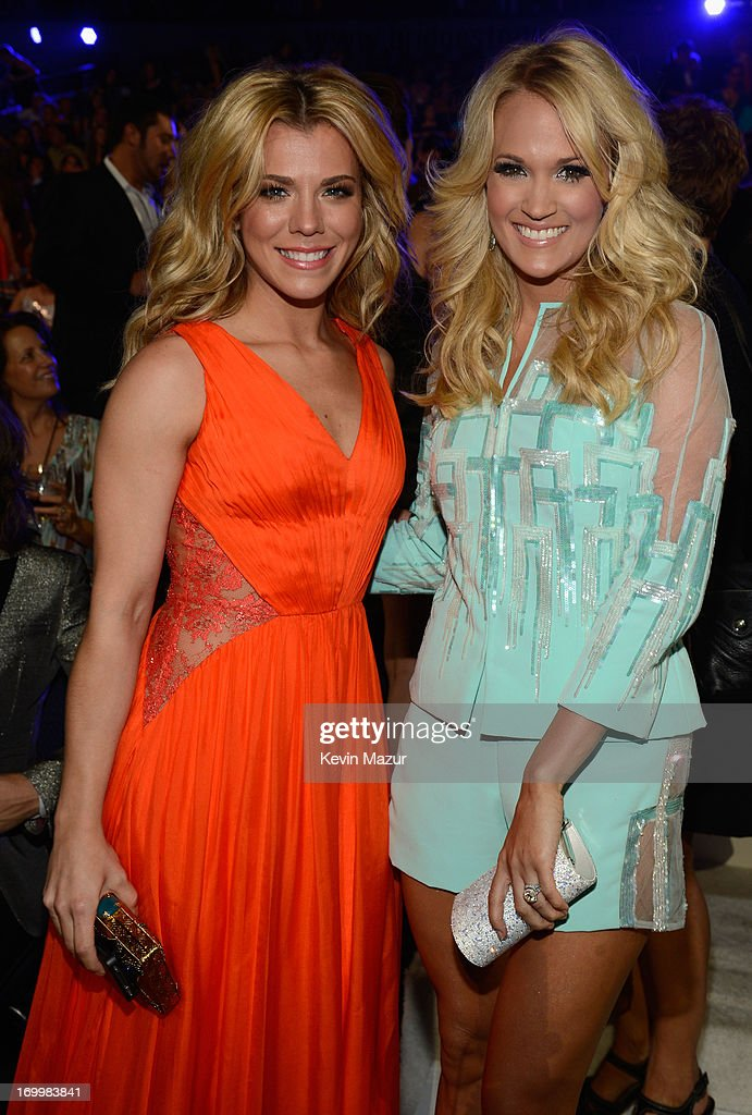 Singers Kimberly Perry (L) and Carrie Underwood attend the 2013 CMT Music awards at the Bridgestone Arena on June 5, 2013 in Nashville, Tennessee.