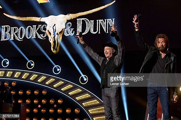Singers Kix Brooks and Ronnie Dunn of Brooks Dunn accept the Nash Icon award onstage during the 2016 American Country Countdown Awards at The Forum...