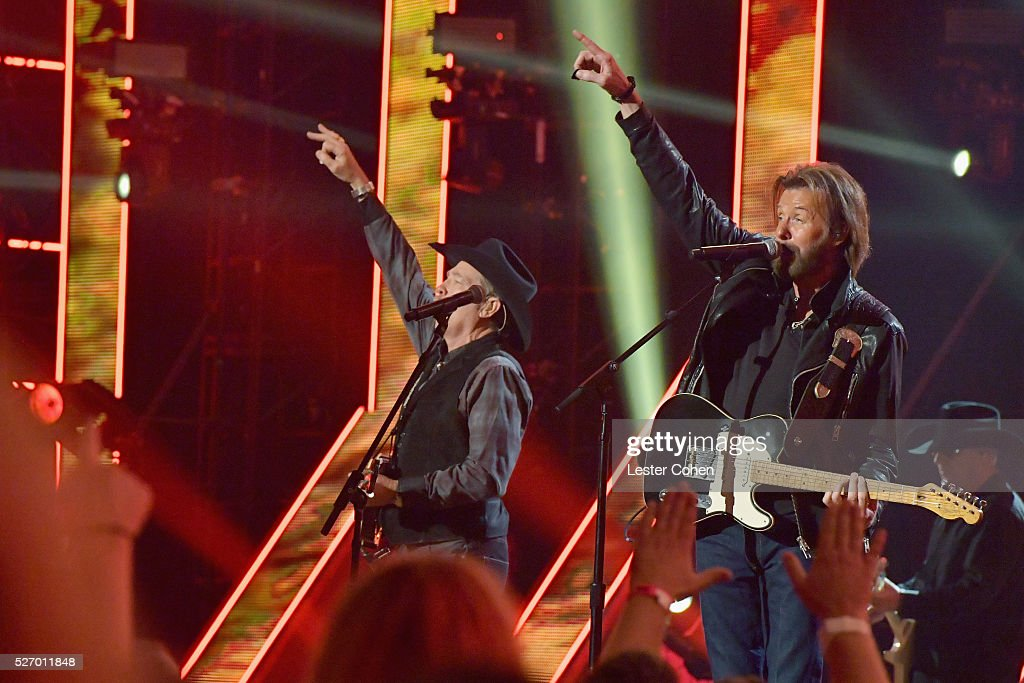 Singers Kix Brooks (L) and Ronnie Dunn of Brooks & Dunn perform onstage during the 2016 American Country Countdown Awards at The Forum on May 1, 2016 in Inglewood, California.